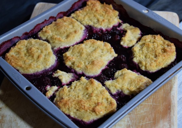 stardew valley blackberry cobbler dish on a wooden cutting board