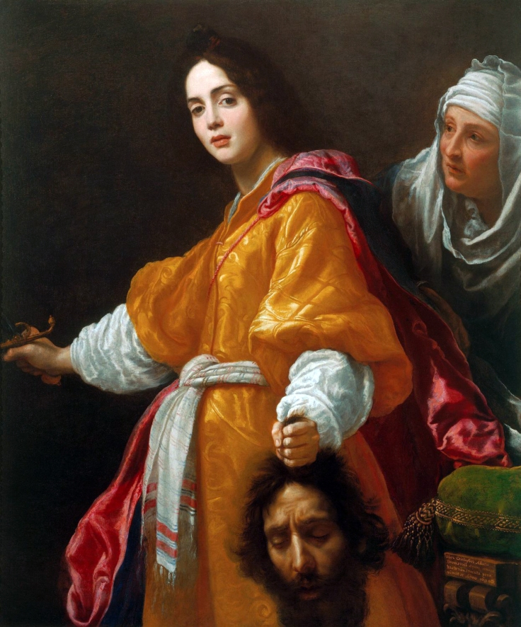 Judith stares at the viewer while holding a sword and the head of Holofernes, with her maid behind her