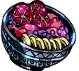 A silver decorated bowl filled with a bright pink mush, sliced red pomegranates, purple grapes, and undetermined golden slices.
